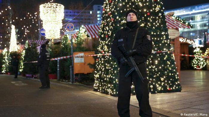 German police officers secure the site of an accident with a truck at a Christmas market (Reuters/C. Mang)