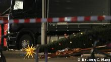 19.12.2016*** A Christmas tree lies next to a truck following an accident with the truck on Breitscheidplatz square near the fashionable Kurfuerstendamm avenue in the west of Berlin, Germany, December 19, 2016. REUTERS/Christian Mang