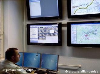 A guard monitoring border traffic