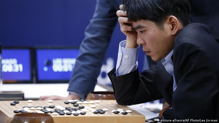 Go champion Lee Sedol reviews his game after getting crushed Google DeepMind's artificial intelligence, AlphaGo