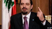 Saad Hariri, the son of Rafik Hariri the late Lebanese prime minister and majority leader, speaks during an interview with the Associated Press, at his house in Beirut, Lebanon, Tuesday Feb. 12, 2008. Hariri said the majority does not intend to start a civil war but will not stand idle and he called on the army to prevent strife. He has blamed the opposition and its Syrian and Iranian backers for undermining Lebanon.(AP Photo/Hussein Malla)