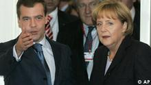 German Chancellor Angela Merkel, right, and Russian President Dmitry Medvedev, left, seen during a meeting in St. Petersburg, Russia, Thursday, Oct. 2, 2008. German Chancellor Angela Merkel met with Russia's president on Thusday for talks expected to focus on the crisis in Georgia, a day after EU monitors began patrolling Georgian territory. (AP Photo/Dmitry Lovetsky)
