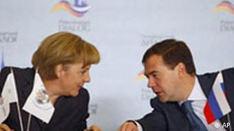 German Chancellor Angela Merkel, left, and Russian President Dmitry Medvedev attend the Russian-German forum St.Petersburg Dialogue at St. Petersburg's University in St. Petersburg, Russia, Thursday, Oct. 2, 2008