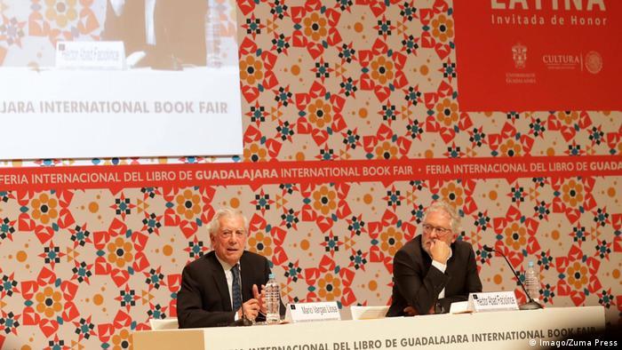 Héctor Abad (right) with Mario Vargas Llosa at the International Book Fair in Guadalajara, Mexico
