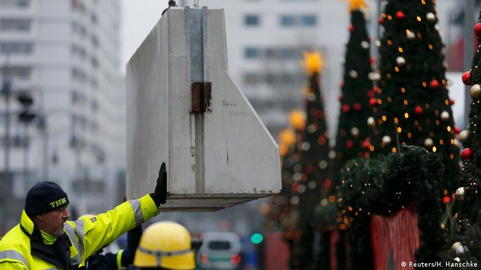 Man putting roadblock in a Christmas market