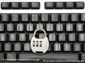 A padlock on a keyboard serves as a symbolic picture of web security