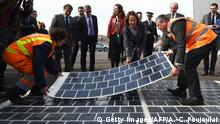 ARCHIV 21.03.2016 ++++ French Ecology Minister Segolene Royal (C) puts solar-powered road panels at the operating centre of the L2 highway in Marseille on March 21, 2016, following a decision by the French government to build over 1,000 kilometres (621 miles) of solar roads within the next five years. / AFP / ANNE-CHRISTINE POUJOULAT (Photo credit should read ANNE-CHRISTINE POUJOULAT/AFP/Getty Images)