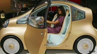 A model sits at the wheel of the Nissan NuVu electric concept car during the second press day of the Paris Auto Show, Friday, Oct. 3, 2008.