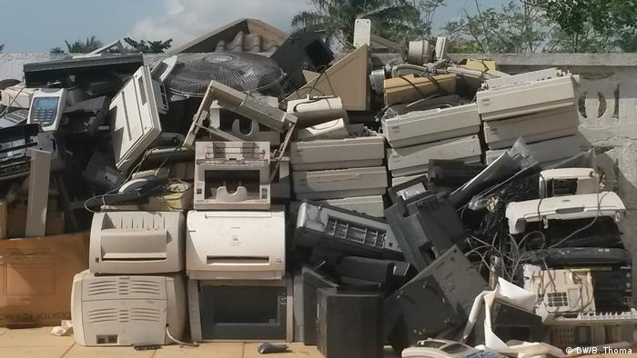 A heap of old printers and other electronic goods