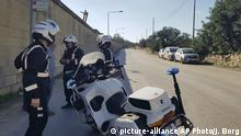 Maltese police officers close off a road by Malta's Luqa International airport after an Afriqiyah Airways plane from Libya landed at the airport in an apparent hijack, Friday, Dec. 23, 2016. Malta's state television says two hijackers who diverted a Libyan commercial plane to the Mediterranean island nation have threatened to blow it up. (AP Photo/Jonathan Borg) |