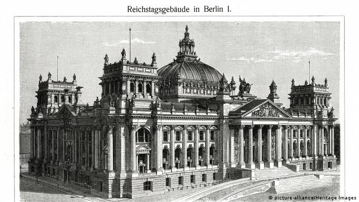 A black-and-white photograph showing the Reichstag building