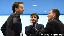Dutch Finance Minister and president of Eurogroup Jeroen Dijsselbloem (L) talks with Greek Finance Minister Euclid Tsakalotos (R) next to a Greek advisor during an Eurogroup meeting in Luxembourg on October 10, 2016. Greece has delivered the reforms necessary to unlock 2.8 billion euros in rescue loans from its massive third bailout, the European Commission's top economics affairs official said on October 10, 2016. / AFP / JOHN THYS (Photo credit should read JOHN THYS/AFP/Getty Images)