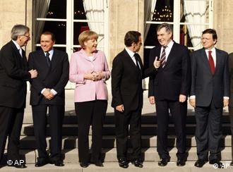 From left to right, Luxembourg's Prime Minister Jean Claude Juncker, Italian Prime Minister Silvio Berlusconi, German Chancellor Angela Merkel, French President Nicolas Sarkozy, British Prime Minister Gordon Brown, European Commission President Jose Manuel Barroso and European Central Bank President Jean Claude Trichet at an emergency financial summit in Paris, Oct. 4, 2008