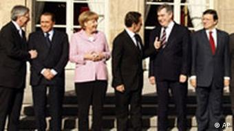 From left to right, Luxembourg's Prime Minister Jean Claude Juncker, Italian Prime Minister Silvio Berlusconi, German Chancellor Angela Merkel, French President Nicolas Sarkozy, British Prime Minister Gordon Brown, European Commission President Jose Manuel Barroso and European Central Bank President Jean Claude Trichet stand for a group photo during an emergency financial summit at the Elysee Palace in Paris, Saturday Oct. 4, 2008