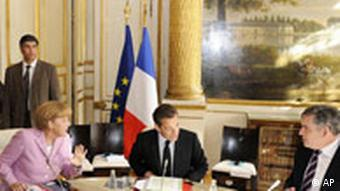 German Chancellor Merkel with French President Sarkozy and British Premier Brown