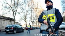 December 24, 2016*** Italian police officers stand guard at a security check-point in a central street of Rome on December 24, 2016. / AFP / Andreas SOLARO (Photo credit should read ANDREAS SOLARO/AFP/Getty Images)