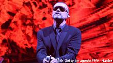 """British singer George Michael performs on stage during his European tour, """"Symphonica at the Palais Nikaia in the French riviera city of Nice on September 22, 2011. AFP PHOTO VALERY HACHE (Photo credit should read VALERY HACHE/AFP/Getty Images)"""