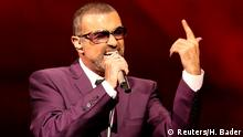 FILE PHOTO British singer George Michael performs on stage during his Symphonica tour concert in Vienna September 4, 2012. REUTERS/Heinz-Peter Bader FOR EDITORIAL USE ONLY