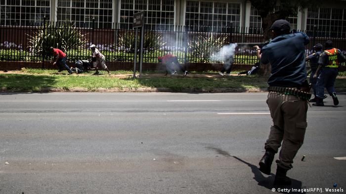Security forces firing rubber bullets at protesters