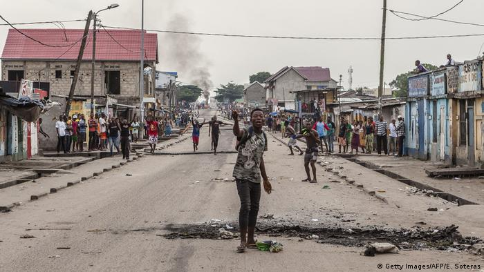 man screams as people gather to protest in the neighbourhood of Yolo in Kinshasa