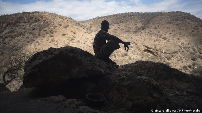A man seated on a rocky outcrop in Somaliland