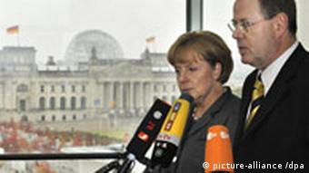 Angela Merkel and Finance Minister Peer Steinbrueck