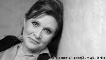 CARRIE FRANCES FISHER (October 21, 1956 December 27, 2016) the actress best known as Star Wars Princess Leia Organa, has died after suffering a heart attack. She was 60. Pictured: October 9, 2012 - Beverly Hills, CA, USA - Actress Carrie Fisher poses during an interview at her home in Coldwater Canyon in 2012 |