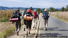 Pilger auf dem Weg von Gonzar nach Palas de Rei
