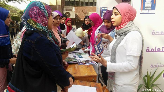 Female university students raising awareness about sexual harassment at a booth at Ain Shams University in Cairo