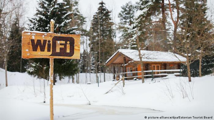 A Wifi sign next to a snowed in hut in Estonia