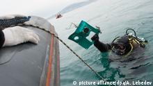 12/28/2016*** 3004787 12/28/2016 An Emergencies Ministry diver brings a fragment of the crashed Tu-154 plane during a search operation at the crash site in the Black Sea near Sochi. Artur Lebedev/TASS/POOL/Sputnik |