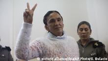 Activist Milagro Sala flashes the victory sign before being given a guilty verdict at a courtroom in San Salvador de Jujuy, in the northern Argentine province of Jujuy, Wednesday, Dec. 28, 2016. Sala was found guilty for instigating a violent protest in which demonstrators threw eggs at Gerardo Morales, a politician who is now the governor of Jujuy, but will not serve time in jail. However, she will stay in prison where she has been since December 2015 for other causes. (AP Photo/Gianni Bulacio) |