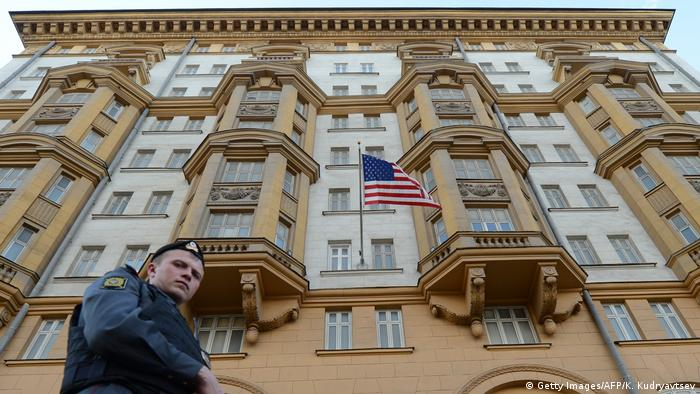 Russian police officers patrols in front of the US embassy building in Moscow