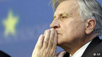 European Central Bank President Jean-Claude Trichet looks on during a news conference