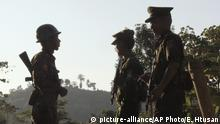 In this Nov. 30, 2016 photo, three Kachin Independence Army (KIA) soldiers patrol along the bunker at the front line of on a mountain near Laiza, the headquarters of KIA in Kachin State, Myanmar. Ethnic Kachin rebels long at war with Myanmar troops say the government has only escalated fighting since Aung San Suu Kyi took over as leader, crushing the hopes that had led many ethnic minorities to support her party and leaving them with no confidence in the peace process that Suu Kyi has identified as a priority.(AP Photo Esther Htusan) |