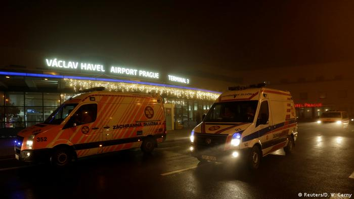 Ambulances arrive at Vaclav Havel Airport (Reuters/D. W. Cerny)