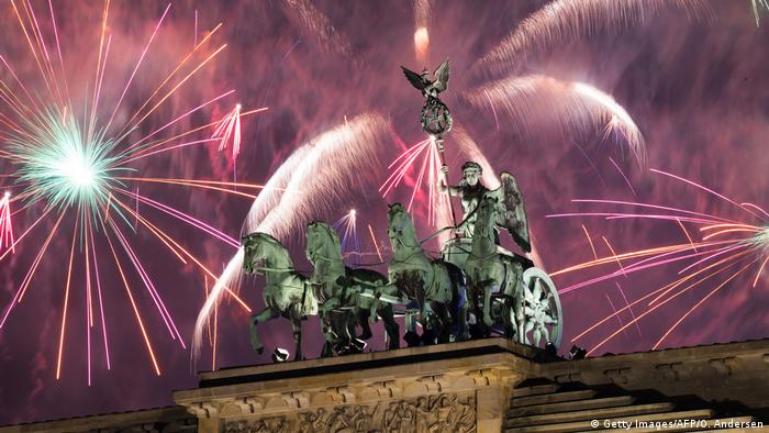 Fireworks explode behind the quadriga of Berlin's landmark Brandenburg Gate (Getty Images/AFP/O. Andersen)