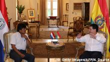 January 2, 2017*** Paraguay's President Horacio Cartes (R) and Bolivian President Evo Morales meet at the presidential house in Asuncion on January 2, 2017. Morales is in Paraguay on official visit. / AFP / NORBERTO DUARTE (Photo credit should read NORBERTO DUARTE/AFP/Getty Images)