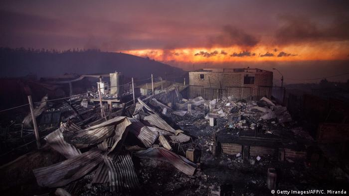 What is left of a house destroyed by the flames in Valparaiso, Chile