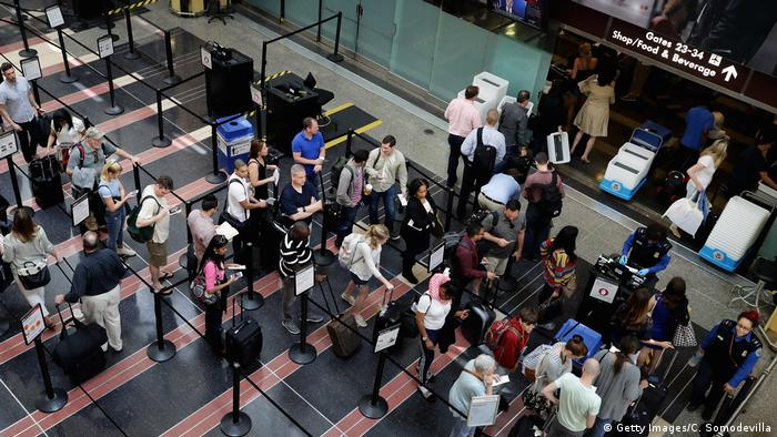 Passengers queue up outside a Transportation Security Administration checkpoint at Ronald Reagan National Airport