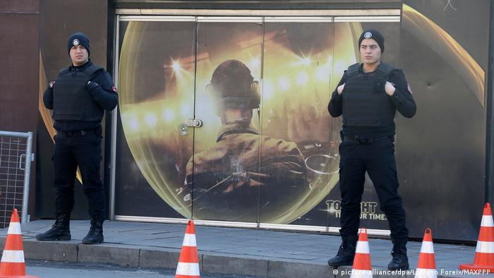 Turkish police officers stand in front of the Reina nightclub