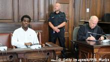 Defendant Harry S attends a hearing on June 22, 2016 at a court in Hamburg. The 27-year-old German national, is accused of beeing a member of the organization Islamic State of Iraq and Greater Syria (IS) and violating the War Weapons Control Act. Harry S was arrested on his return from Syria on July 20, 2015 in Bremen. / AFP / POOL / Bodo Marks (Photo credit should read BODO MARKS/AFP/Getty Images)