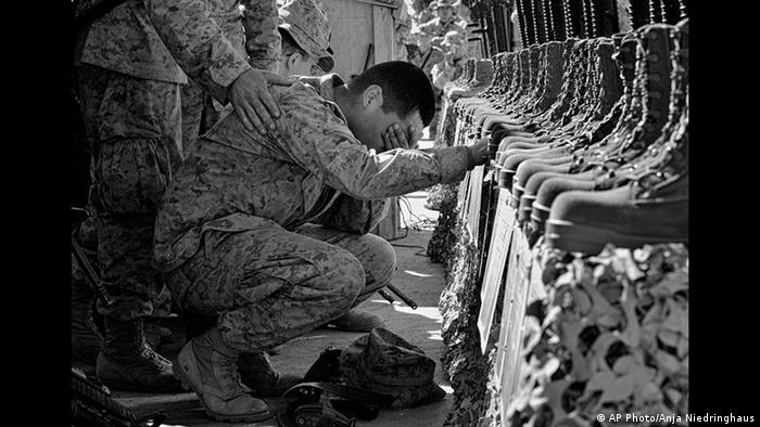 Photo by Anja Niedringhaus: A US marine is lost in grief over comrades kiled in Iraq (AP Photo/Anja Niedringhaus)