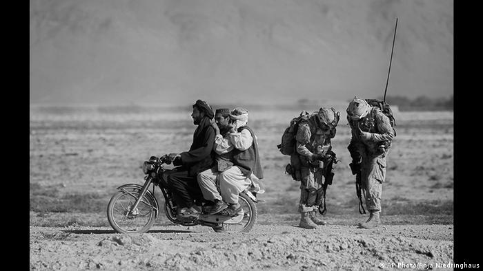 Photo by Anja Niedringhaus: motorcycling in Afghanistan