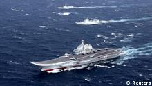 Dezember 2016 **** China's Liaoning aircraft carrier with accompanying fleet conducts a drill in an area of South China Sea, in this undated photo taken December, 2016. REUTERS/Stringer ATTENTION EDITORS - THIS IMAGE WAS PROVIDED BY A THIRD PARTY. EDITORIAL USE ONLY. CHINA OUT.