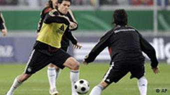 German captain Michael Ballack runs with the ball during a public training session of the German national soccer team