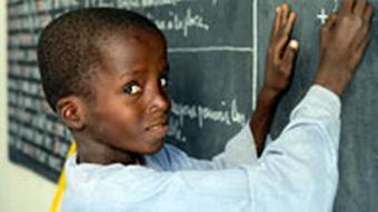Child writing on blackboard
