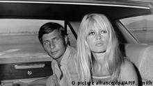 French film actress Brigitte Bardot and her husband, German playboy Gunter Sachs pose just before boarding a chartered airplane on their honeymoon in Las Vegas on July 14, 1966. They were married early this morning at the home of a Las Vegas lawyer. (AP Photo/David F. Smith) |