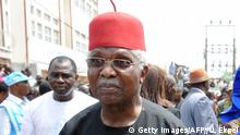 Former Nigerian Vice President Alex Ekwueme and his wife Beatrice arrive to attend the funeral service at St Michaels Catholic Church during the burial of Nigeria's secessionist leader Odumegwu Ojukwu at his native Nnewi country home in Anambra State eastern Nigeria, on March 2, 2012. Odumegwu Ojukwu, who championed the campaign for an independent Republic of Biafra in eastern Nigeria in the 1960s culminating in a 30-month civil war which left more than a million dead was buried at his Nnewi family home in Anambra State. AFP PHOTO/ PIUS UTOMI EKPEI (Photo credit should read PIUS UTOMI EKPEI/AFP/Getty Images)