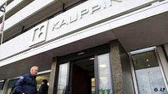 A man walks past a branch of Iceland's Kaupthing bank.